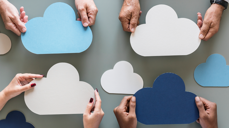 hands holding cloud-shaped papers