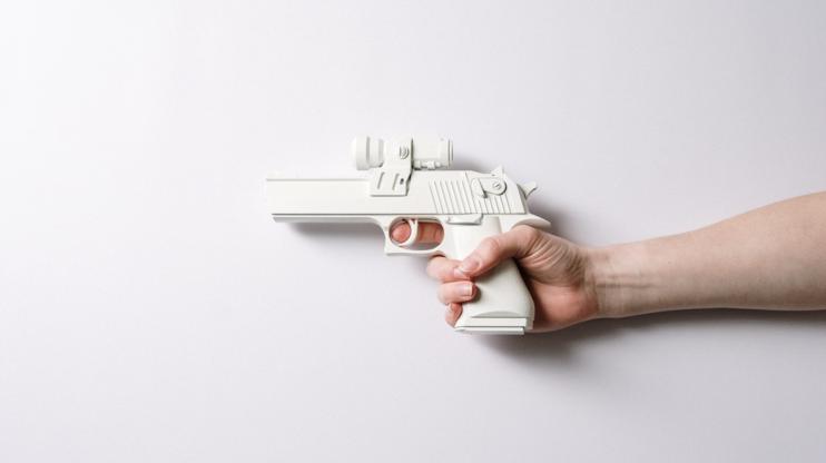 Hand holding a white gun