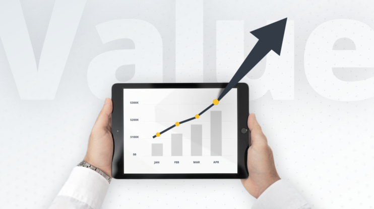 tablet presenting a bar chart with an upward rising arrow